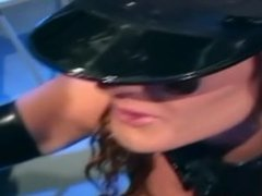 Busty brunette in a shiny latex costume and latex gloves fucking in jail