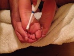 Young woman's feet tickled.