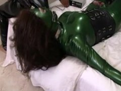 Rubber Shemale Sex Slave sucks cock