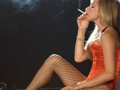 Pornstar Chloe Toy smoking in a basque and stockings