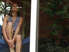 Sexy girl masturbates in the window