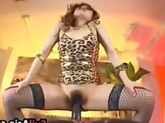 Asian Slut With A Huge Dildo