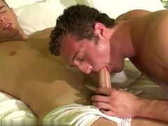 Gay video He pulls it out of the trunks and pushes it into his