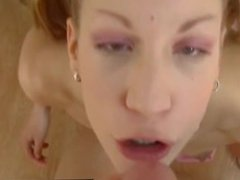 Pigtailed cutie gives POV blowjob