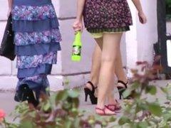 girls walking down the street - legs ass and heels
