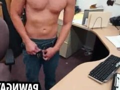 Amateur hunk posing for some photos at the pawn shop