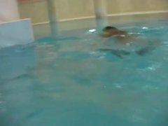 Young lezzies getting nude in swimming pool