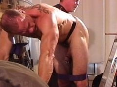 Ball Bashing and Big Black Butt Plug in muscle hunk's butt hole.