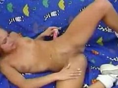 Young Cute Girl with Pigtails Masturbates with Dildo