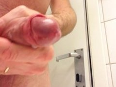 Handjob on a shaved dick.