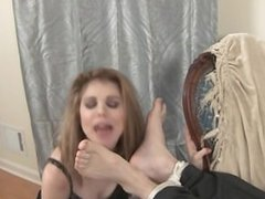 Woman worships male feet.
