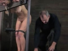 Gagged submissive restrained in stocks