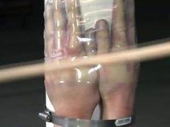 BDSM sub restrained awkwardly and caned