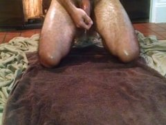 Hung stud oils and cums on chest by fireplace