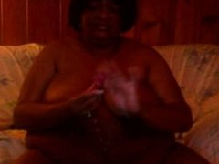 Black BBW plays with herself