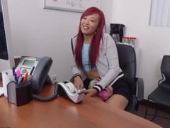 Red haired Asian beauty Miko Dai fucks in the office
