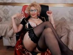 Blonde granny fingers her pussy on webcam