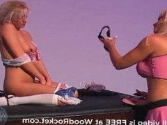Milf whips and spanks young blonde