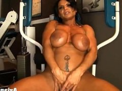 FEMALE BODYBUILDER WORKS UP A SWEAT AND STRIPS NAKED