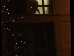 My wife fucks her dildo on hotel window for anyone to see