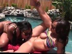 Ebony lesbians pussy play by the pool
