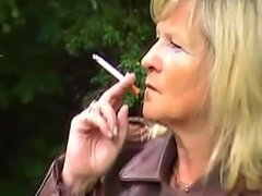 Gloria-Mature Bikerlady Smoking in full leather Outfit.
