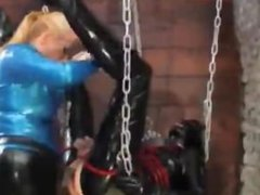 Latex couple Strapon fucking in sex swing BDSM