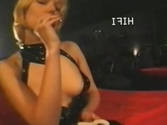 Expensive whore smoking while working.