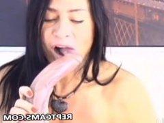 horny milf brunette sucking a big dildo