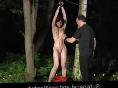 Bondage ceremony in the woods at midnight