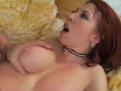 Busty redhead MILF in fishnet stockings fucked hard on bed