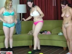Two girls play a strip memory game