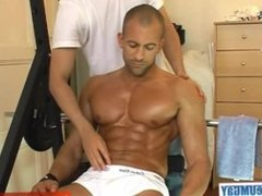 Athletic guy get massaged and get wanked by a guy in spite of him !