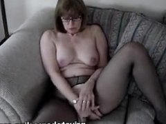 Mature fingering on sofa