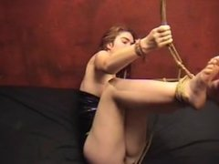 Girl Struggles in Bondage
