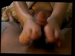 Beautiful eighteen gives a footjob with her perfect feet