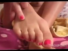 Slowly massage her feet and toes