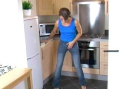 Natalia wets pants in kitchen