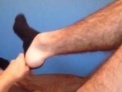 Guy jerks off to feet