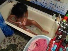 hot latina girl masturbates in the bathtub