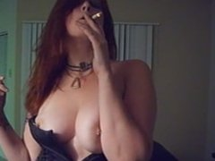 Saphire enjoying a cigarette in a sexy black corset