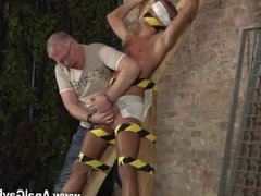 Gay movie of Blindfolded, gagged, tantalized and flogged, the man is