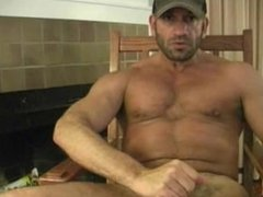 Muscle hunk shoots his load on his face