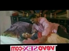 South Indian Aunty on bed