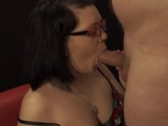 Girl with glasses sucks and gets cum on face.