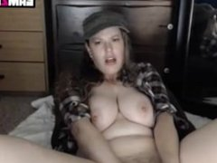 Sexy young brunette like a farmer with big boobs playing with a dildo