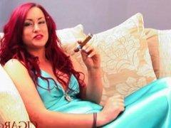 Emma smokes cigar