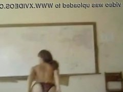 college girl with hot body performing a striptease