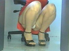 Office girl squatting upskirt in stockings