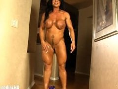 Bodybuilder flexes her big muscles, gets naked and masturbates